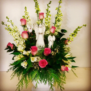 Among The Angels Pink Roses and White Filler Accent with 2 Beautiful Ceramic Angels in Plainview, TX | Kan Del's Floral, Candles & Gifts
