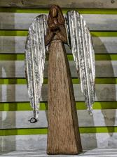 Wooden angel with tin wings