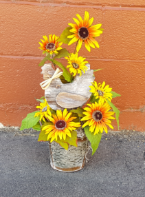 Wooden chicken, sunflowers in a tin container Silk flower arrangement