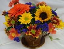 Cute Tin Teacup with seasonal flowers arranged!