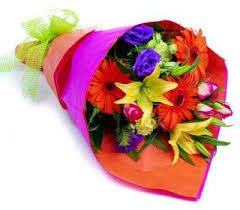 pick of the day bouquet wrapped we will choose the best selection mix for you that is available for the day in Lebanon, NH | LEBANON GARDEN OF EDEN FLORAL SHOP
