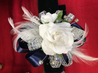 Wrist Corsage Beautiful silk white rose wrist corsage with double ribbon and sones.