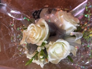 wrist corsage white with a pop of black prom corsage
