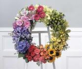WRlEATH SUNSET ARRANGEMENT OF FLOWERS