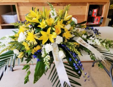 yellow and white spray casket spray