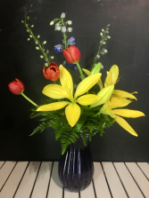YELLOW LILLIES IN COBALT VASE FLORAL