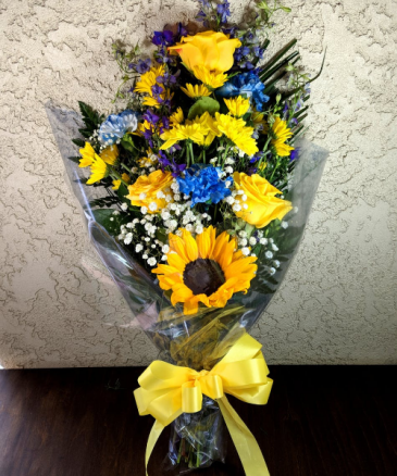 YELLOW ROSE, SUNFLOWER AND BLUE CARNATION WRAPPED BOUQUET