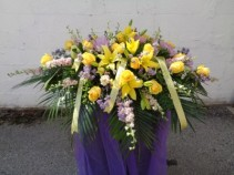YELLOW SYMPATHY CASKET FLOWERS