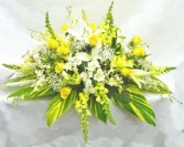 GOLDEN SUNSHINE  Half Casket Spray of seasonal shades of yellows and whites. Roses, snap dragons, lillies and more.