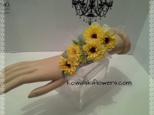 Yellow Viking Poms Wrist Corsages in Whitesboro, NY | KOWALSKI FLOWERS INC.