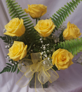 6 Yellow Roses arranged with baby's breath or wax  flower in a vase.