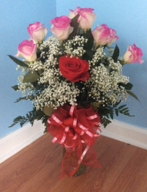 You are one of a kind 11 variegated pink roses and one red rose