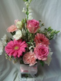 """You're One in a Million"" Pink and white flowers.. roses, carnations, gerberas and other seasonal flowers all arranged in a cube rectangular vase with pink and white ribbon."