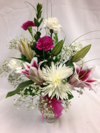 You're So Special Lilies, Fuji mums, carnations and accents. in whites and pinks