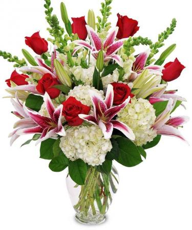 Love You More! Exquisite display of roses, lillies, and hydrangea